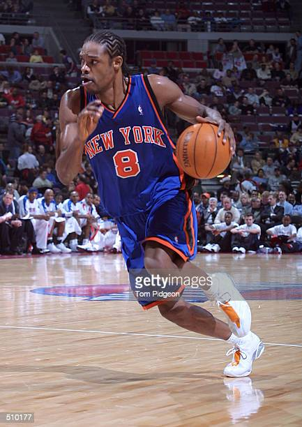 Latrell Sprewell of the New York Knicks drives against the Detroit Pistons during the second half at The Palace in Auburn Hills Michigan DIGITAL...