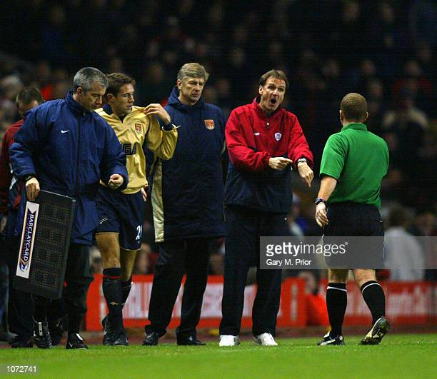 Liverpool assistant manager Phil Thompson moans to referee Paul Durkin as Arsenal manager Arsene Wenger prepares to bring on Matthew Upson for the...