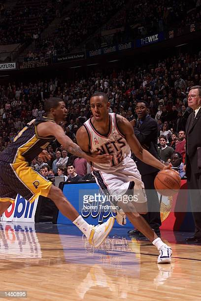 Lucious Harris of the New Jersey Nets drives the lane against Jalen Rose of the Indiana Pacers during the game at Continental Airlines Arena in East...