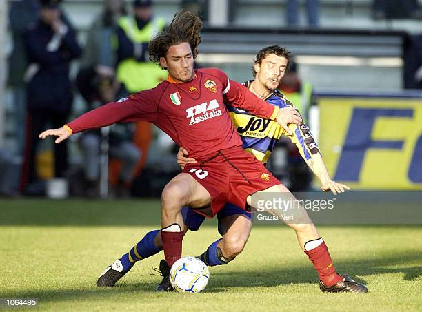 Luigi Sartor of Parma and Francesco Totti of Roma in action during the Serie A 14th Round League match between Parma and Roma played at the Ennio...