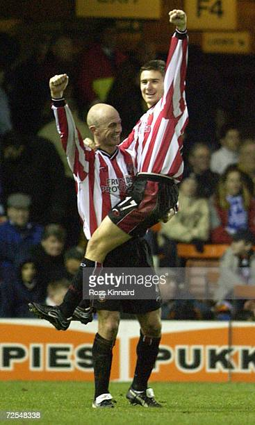 Marian Pahars and Chris Marsden of celebrate after the fourth goal during the match between Leicester City and Southampton in the FA Barclaycard...