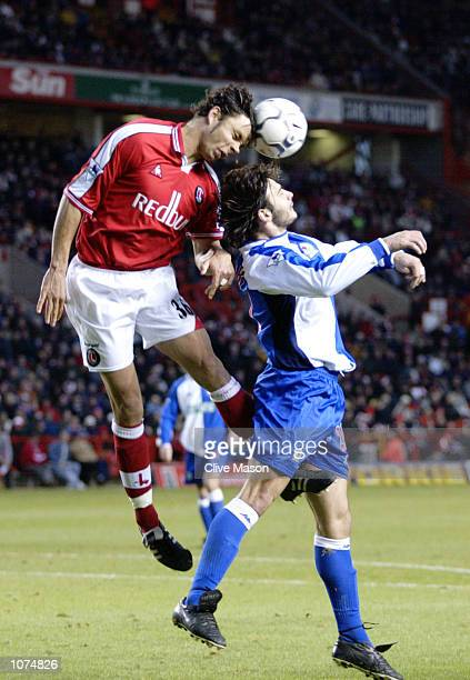 Mark Fish of Charlton Athletic rises above Corrado Grabbi of Blackburn Rovers during the FA Barclaycard Premiership match played at The Valley in...