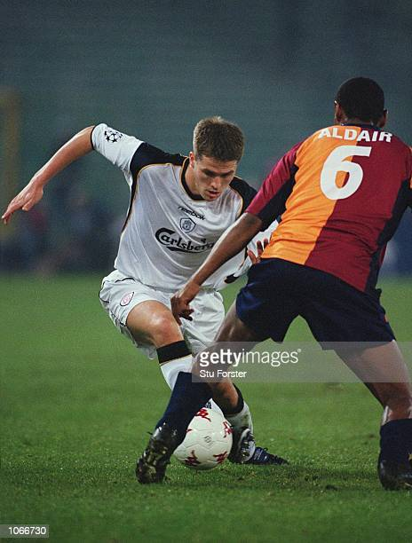 Michael Owen of Liverpool takes on Aldair of Roma during the UEFA Champions League Group B match at the Stadio Olimpico in Rome Italy The game ended...