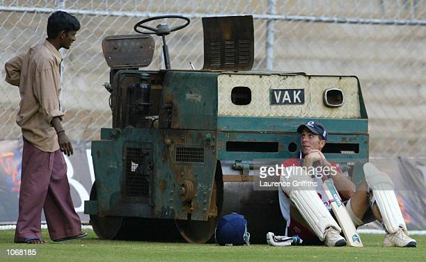 Michael Vaughan of England speaks to a local groundsman during net practice ahead of the final Test Match against India at the China Swamy Stadium in...