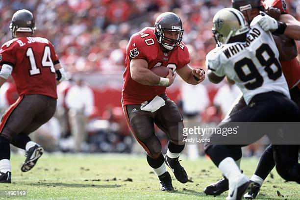 Mike Alstott of the Tampa Bay Buccaneers carries the ball up the field during the game against the New Orleans Saints at Raymond James Stadium in...