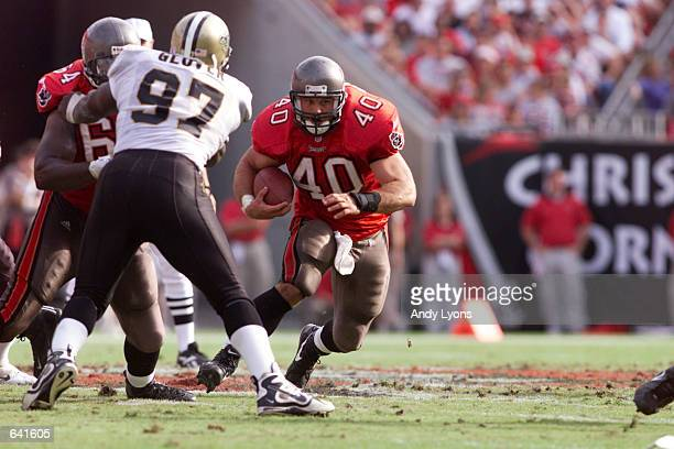 Mike Alstott of the Tampa Bay Buccaneers maneuvers against the defense of the New Orleans Saints during the game at Raymond James Stadium in Tampa...
