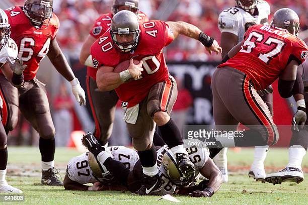 Mike Alstott of the Tampa Bay Buccaneers outruns the New Orleans Saints during the game at Raymond James Stadium in Tampa Florida The Buccaneers won...