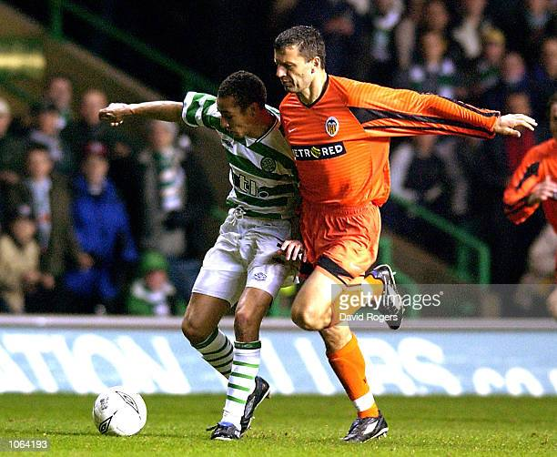 Miroslav Djukic of Valencia tackles Henrik Larsson of Celtic during the UEFA Cup third Round second Leg match between Celtic and Valencia at Celtic...