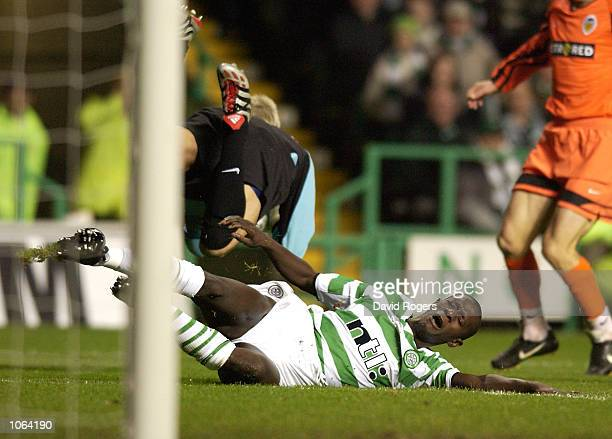 Momo Sylla of Celtic clashes with Valencia keeper Santiago Canizares during the UEFA Cup third Round second Leg match between Celtic and Valencia at...