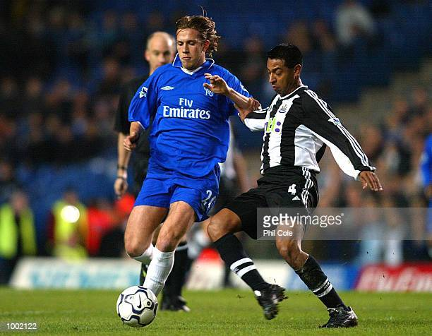 Nolberto Solano of Newcastle comes into challenge Sam Dalla Bona of Chelsea during the Worthington Cup Quarter Final match between Chelsea and...