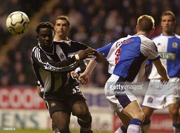 Olivier Bernard of Newcastle holds off the Blackburn defence during the FA Barclaycard Premiership game between Newcastle United and Blackburn Rovers...