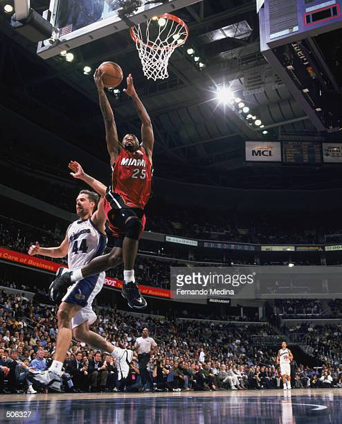 Point guard Anthony Carter of the Miami Heat shoots a layup during the NBA game against the Wahington Wizards at the MCI Center in Washington DC The...