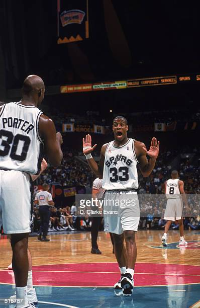 Point guard Antonio Daniels and point guard Terry Porter both of the San Antonio Spurs celebrate during the NBA game against the Utah Jazz at the...