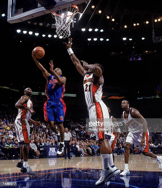 Point guard Chucky Atkins of the Detroit Pistons shoots over forward Danny Fortson of the Golden State Warriors during the NBA game at the Arena in...