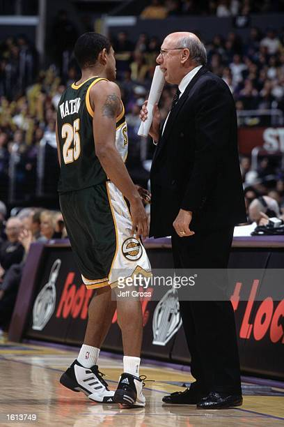 Point guard Earl Watson of the Seattle SuperSonics listens to assistant coach Bob Weiss during the NBA game against the Los Angeles Lakers at the...