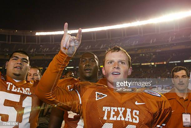 Quarterback Major Applewhite of Texas and teammates celebrate after the Holiday Bowl game against Washington at Qualcomm Stadium in San Diego...
