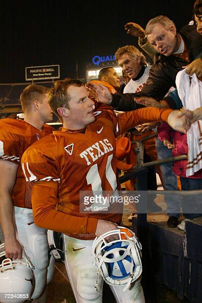 Quarterback Major Applewhite of Texas is congratulated by fans after the Holiday Bowl game against Washington at Qualcomm Stadium in San Diego...