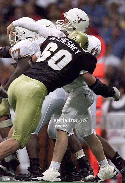 Quarterback Major Applewhite of the Texas Longhorns gets nailed by defensive end Matt McChesney of Colorado Buffaloes as he throws a long pass for a...