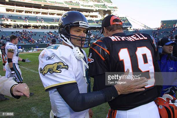 Quarterback Mark Brunell of the Jacksonville Jaguars greets Scott Mitchell of the Cincinnati Bengals after the game at Paul Brown Stadium in...