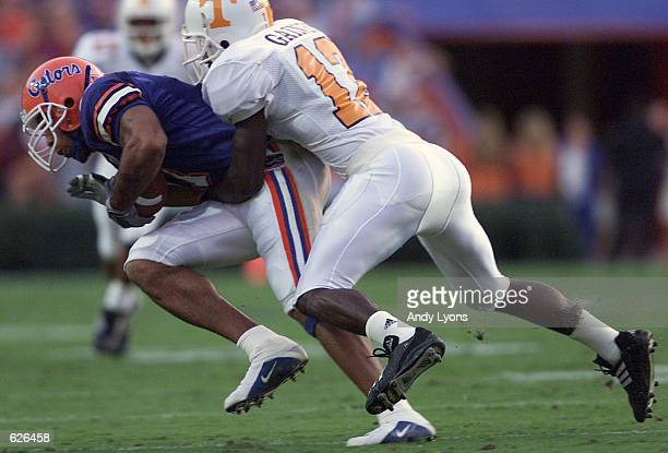 Reche Caldwell of Florida runs with the ball while tackled by Teddy Gaines of Tennessee during a game at Florida Field at the University of Florida...