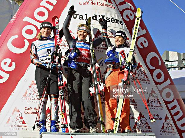 Renate Goetschl of Austria Hilde Gerg of Germany and Tanja Schneider of Austria on the podium following the FIS Ski World Cup 2001/2002 Women's Suoer...