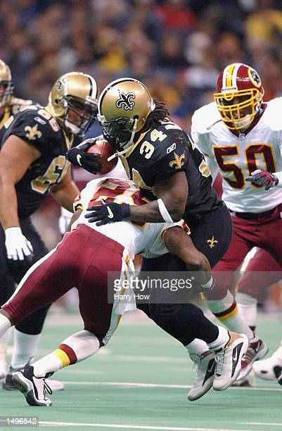 Ricky Williams of the New Orleans Saints is hit by Sam Shade of the Washington Redskins during the game at the Superdome in New Orleans Louisiana The...