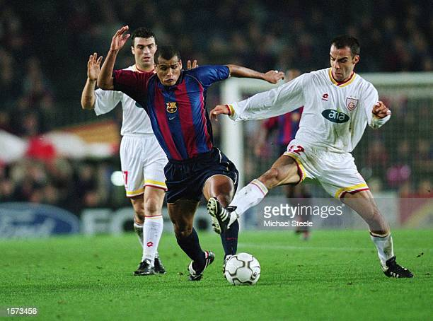 Rivaldo of Barcelona takes on Bulent Akin of Galatasaray during the UEFA Champions League Second Phase Group B match between Barcelona and...