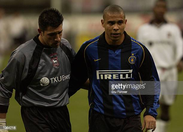 Ronaldo of Inter consoles Matteo Sereni of Ipswich after the UEFA Cup Third Round Second Leg match between Inter Milan and Ipswich Town at the San...