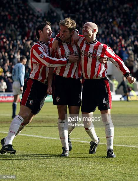 Rory Delap and Chris Marsden of Southampton congratulate goalscorer James Beattie after he scored the winning goal during the FA Barclaycard...