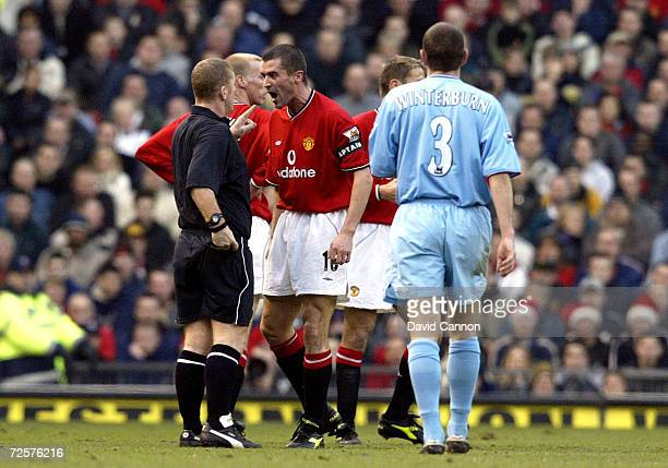 Roy Keane of Manchester United argues with the referee Paul Durkin as his name goes in the book during the FA Barclaycard Premiership match between...