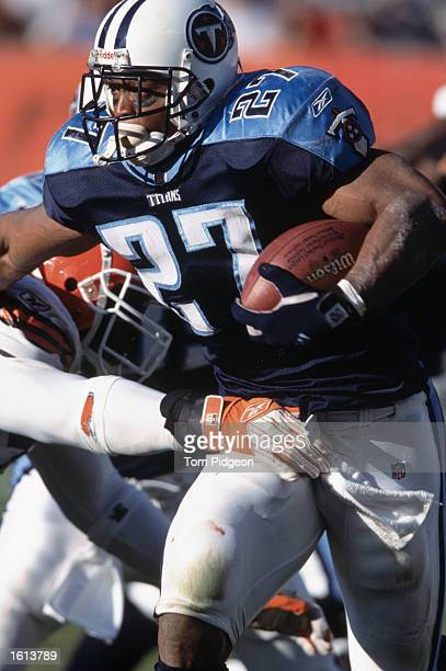 Running back Eddie George of the Tennessee Titans runs with the ball during the NFL game against the Cleveland Browns at Browns Stadium in Cleveland...
