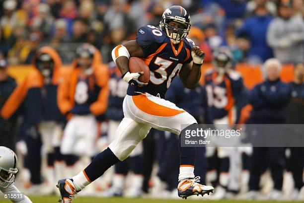Running back Terrell Davis of the Denver Broncos hits his stride with a 34 yard gain against the Oakland Raiders in the second quarter at Mile High...