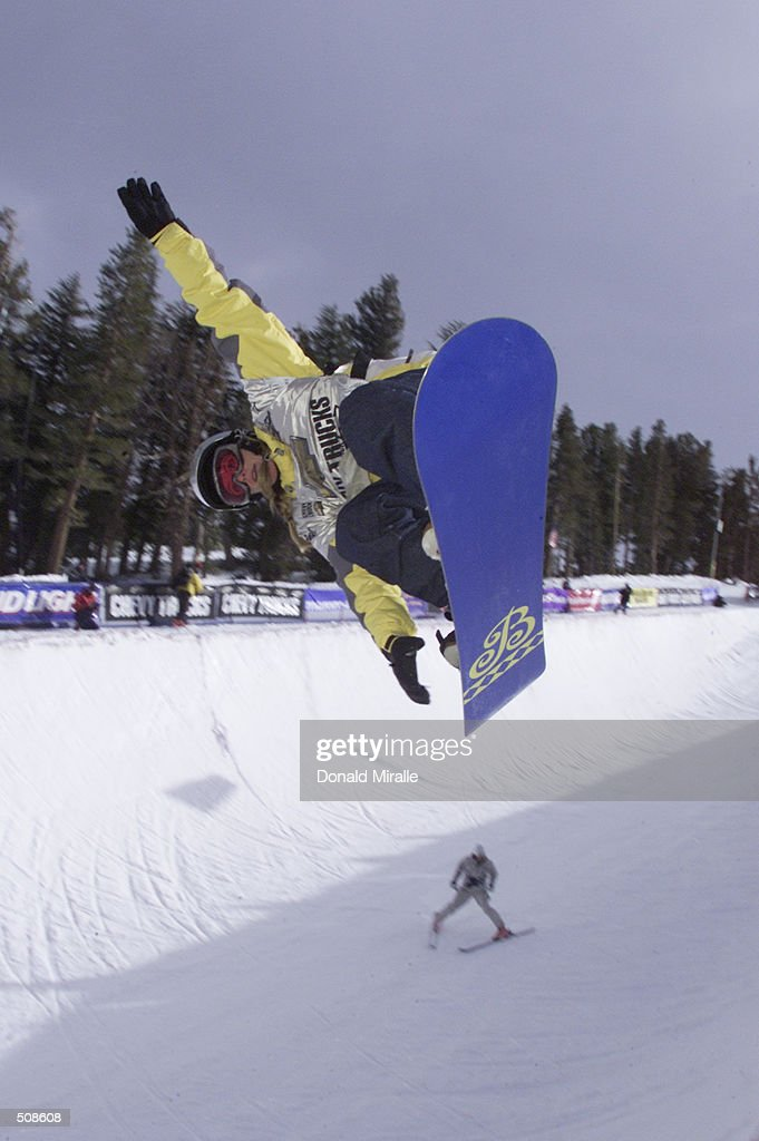 Shannon Dunn of the U.S. gets some air en route to her 1st place finish in the women's half-pipe competition and an automatic berth at the Olympics Games in Salt Lake City during the U.S. Snowboarding Grand Prix in Mammoth Lakes, California. DIGITAL IMAGE. Mandatory Credit: Donald Miralle/ALLSPORT