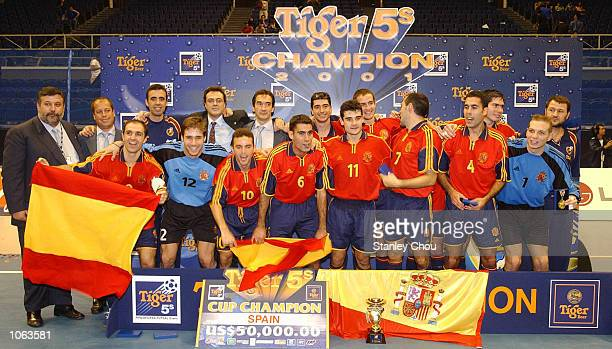 Spain celebrates with the Tiger 5s Cup after beating Brazil in the final during the Tiger 5s International Futsal Tournament held at the Singapore...