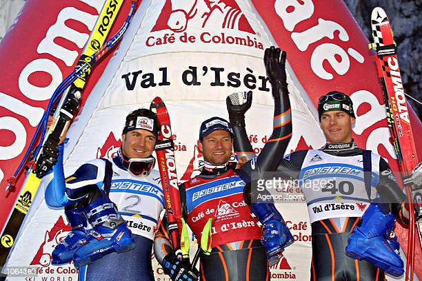 Stefan Eberharter of Austria Kurt Sulzenbacher Italy Michael Walchhofer of Austria stand on the podium after the 20012002 FIS Alpine Ski World Cup...