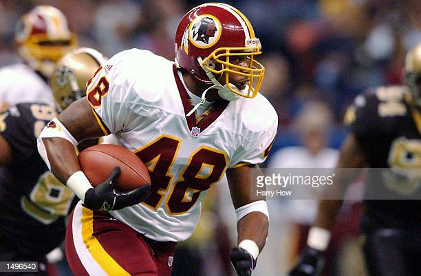 Stephen Davis of the Washington Redskins carries the ball against the New Orleans Saints during the game at the Superdome in New Orleans Louisiana...