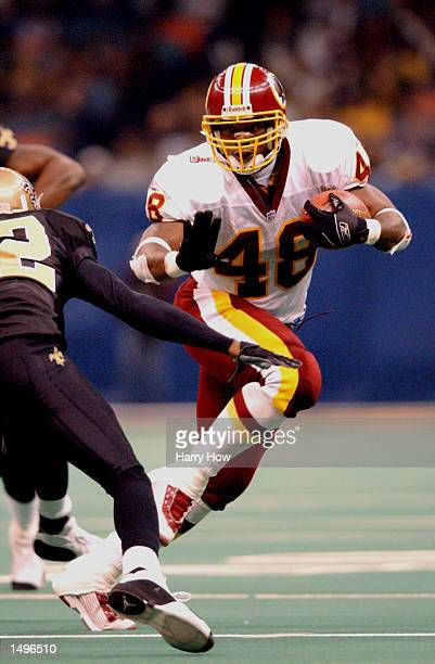 Stephen Davis of the Washington Redskins defends his posession of the ball against the New Orleans Saints during the game at the Superdome in New...