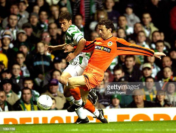 Stilian Petrov of Celtic holds off a challenge from Amedeo Cardoni of Valencia during the UEFA Cup third Round second Leg match between Celtic and...