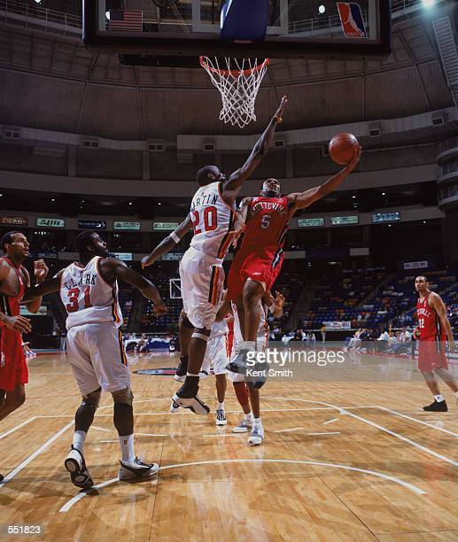 Terrell McIntyre of the Fayetteville Patriots shoots over Terrance Martin of the Huntsville Flight during the NBDL game at Crown Coliseum in...