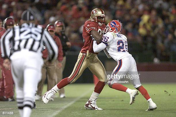 Terrell Owens of the San Francisco 49ers battles Antoine Winfield of the Buffalo Bills during the game at 3Com Park in San Francisco California The...