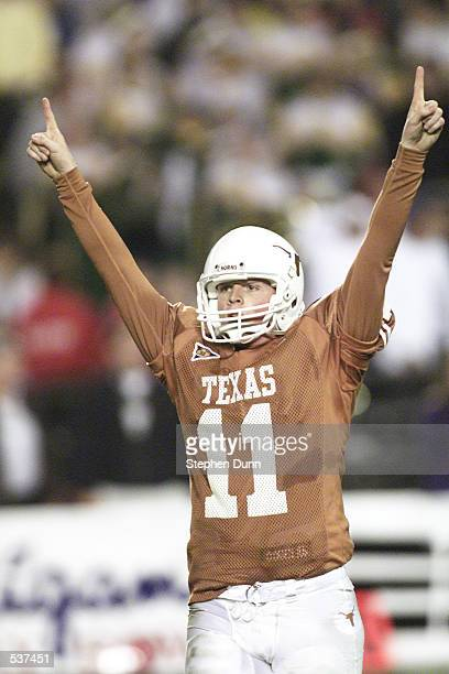 Texas quarterback Major Applewhite celebrates his team's winning touchdown in the final minute of the 2001 Culligan Holiday Bowl versus Washington at...