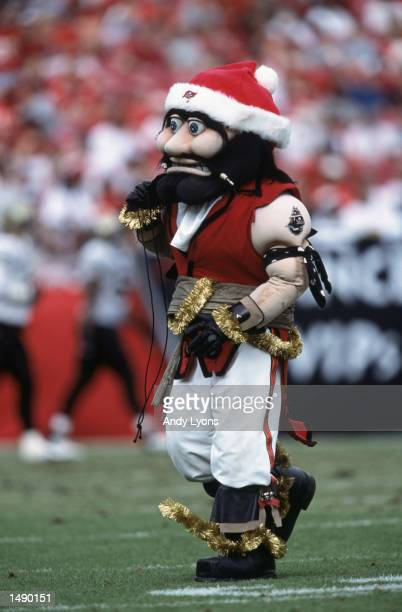 The Tampa Bay Buccaneers mascot wears a santa hat as he walks on the field during the game against the New Orleans Saints at Raymond James Stadium in...
