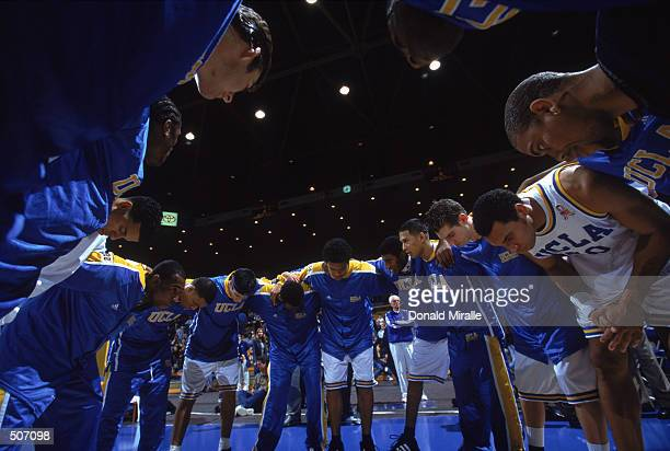 The UCLA team huddles before the NCAA game against the UC Riverside Highlanders at Pauley Pavilion in Westwood California UCLA defeated UC Riverside...