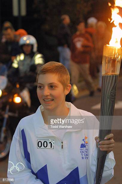 Torchbearer Kerri Costello carries the Olympic Flame during the 2002 Salt Lake Olympic Torch Relay in Memphis Tennessee DIGITAL IMAGE Mandatory...
