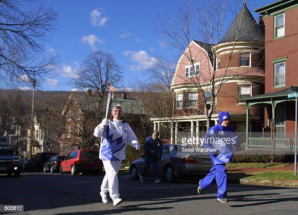 Torchbearer Patricia Brown carries the Olympic Flame during the 2002 Salt Lake Olympic Torch Relay in Cumberland Maryland DIGITAL IMAGE Mandatory...