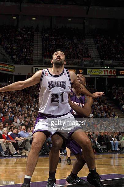 Vlade Divac of the Sacramento Kings battles Alton Ford of the Phoenix Suns for the rebound at the ARCO Arena in Sacramento California DIGITAL IMAGE...