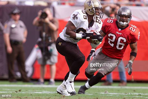 Wane McGarity of the New Orleans Saints is chased by Dwight Smith of the Tampa Bay Buccaneers during the game at Raymond James Stadium in Tampa...