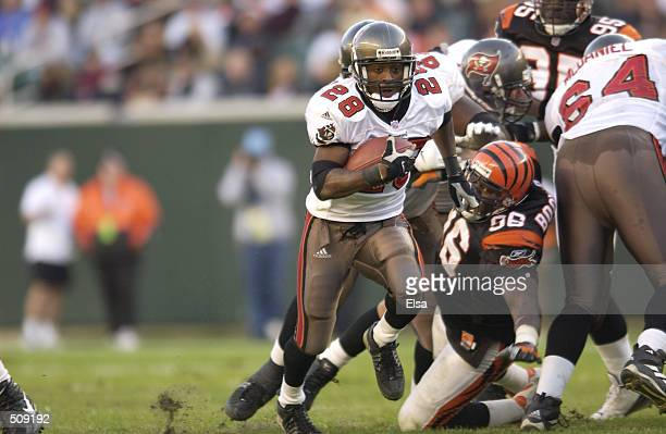 Warrick Dunn of the Tampa Bay Buccaneers in action against the Cincinnati Bengals during the game at Paul Brown Stadium in Cincinnati Ohio The...