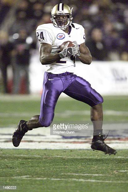 Washington running back Rich Alexis carries the ball versus Texas during the 2001 Culligan Holiday Bowl at Qualcomm Stadium in San Diego California...