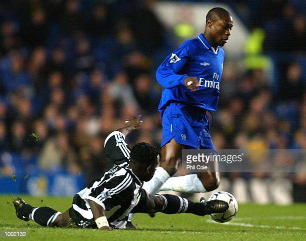 William Gallas of Chelsea gets away from Olivier Barnard of Newcastle during the Worthington Cup Quarter Final match between Chelsea and Newcastle...